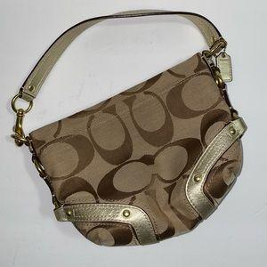 Coach original handbag with gold accents